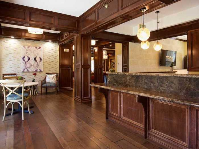 Resort-style front desk at Pacifica Senior Living Oakland Heights
