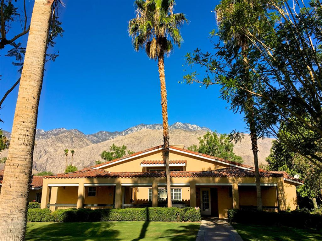 Front entrance lined with Palm Trees at Pacifica Senior Living Palm Springs in Palm Springs, California