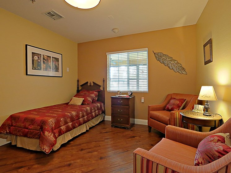 Huge Bedroom with Lounge Chairs at Pacifica Senior Living Peoria, Peoria