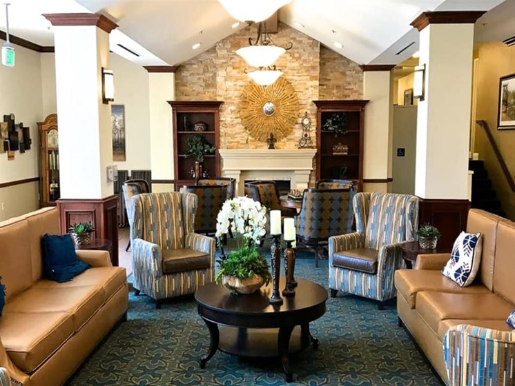 Meet with family in our living area with wood-burning fireplace at Pacifica Senior Living San Leandro in San Leandro, California