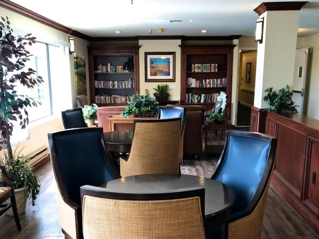 Comfortable activity area with at the library at Pacifica Senior Living San Leandro in San Leandro, Alameda County, California