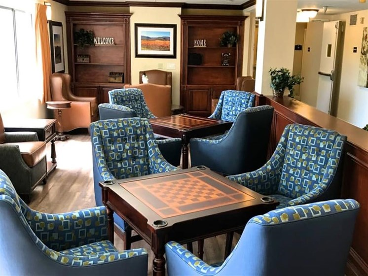 Enjoy music and chess in our community room at Pacifica Senior Living San Leandro in San Leandro, California