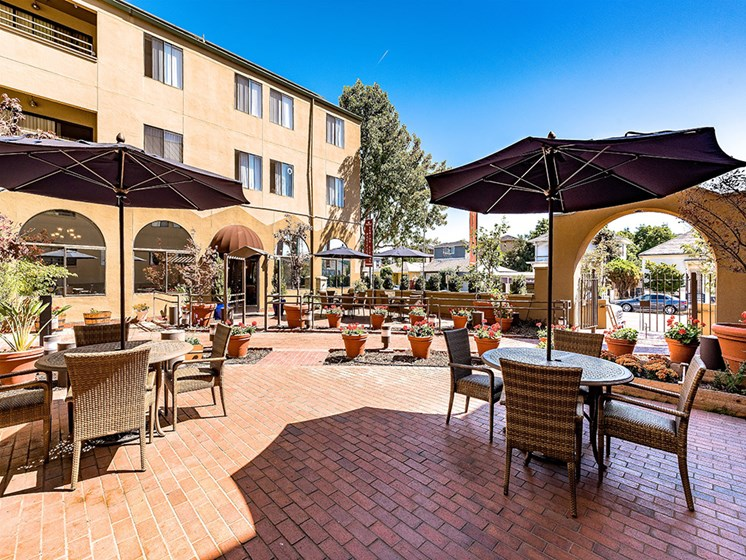 Outdoor Living Area including BBQ's and Fire Pits,at Pacifica Senior Living San Leandro, San Leandro, CA 94577