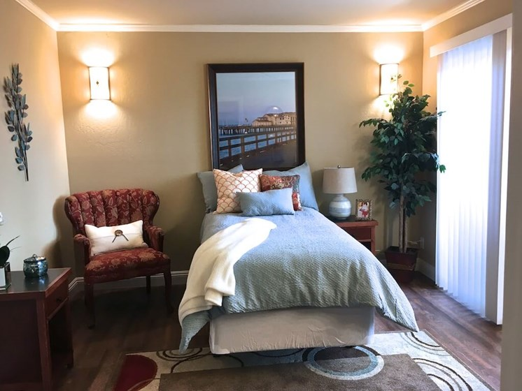 Beautiful comfy bedroom at Pacifica Senior Living Santa Barbara in Santa Barbara, California