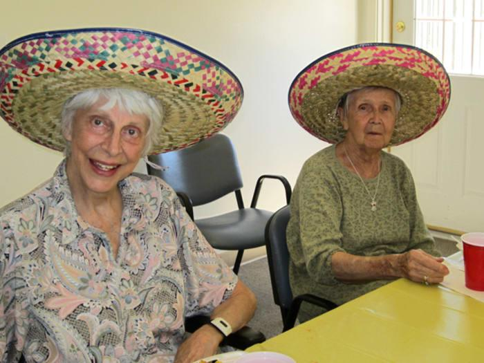 Happy Living Residents at Pacifica Senior Living Tucson partake in salsa tasting