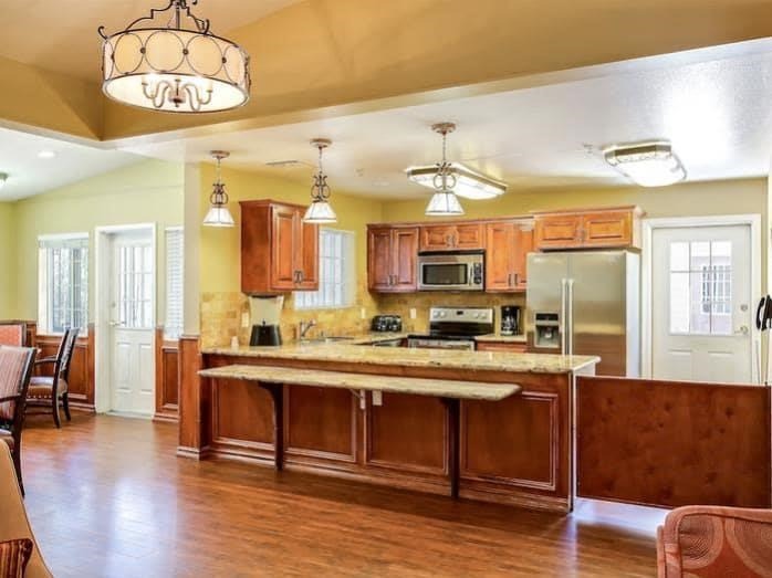 Luxury kitchen with open floorplan at Pacifica Senior Living Tucson in Tucson, AZ