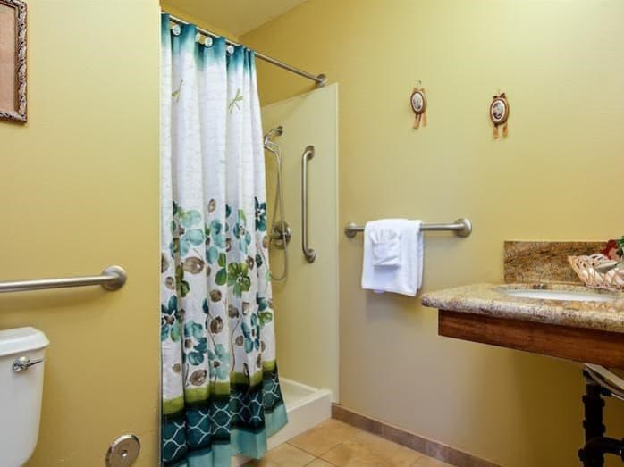 Spacious bathroom with handrails at Pacifica Senior Living Tucson in Tucson, AZ