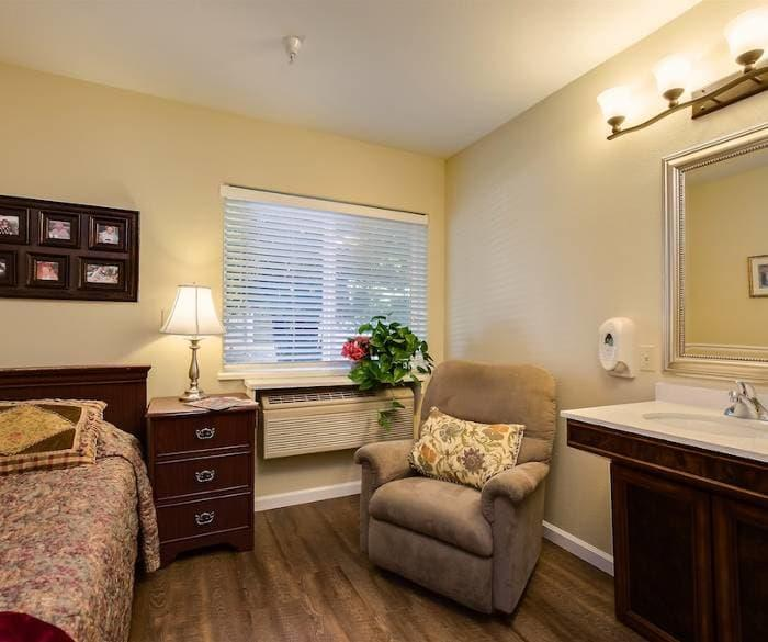 Well decorated bedroom at Pacifica Senior Living Vacaville in Vacaville, California