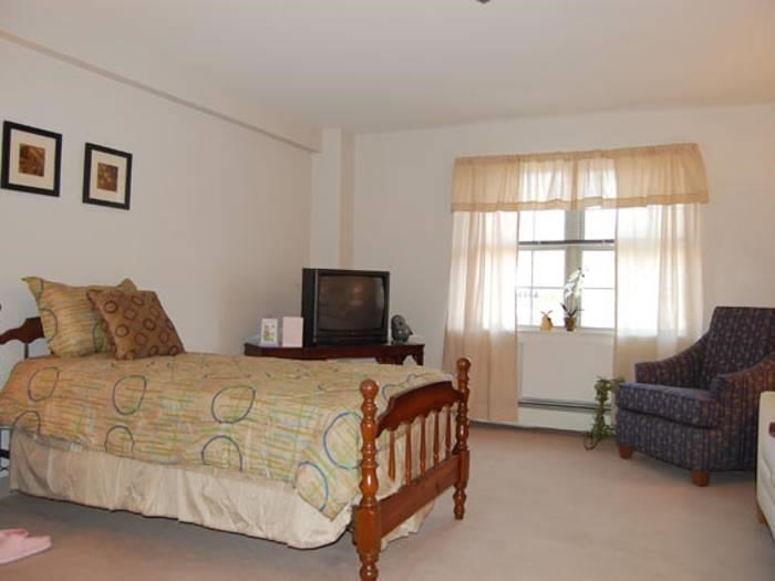 Well decorated bedroom at Pacifica Senior Living Victoria Court