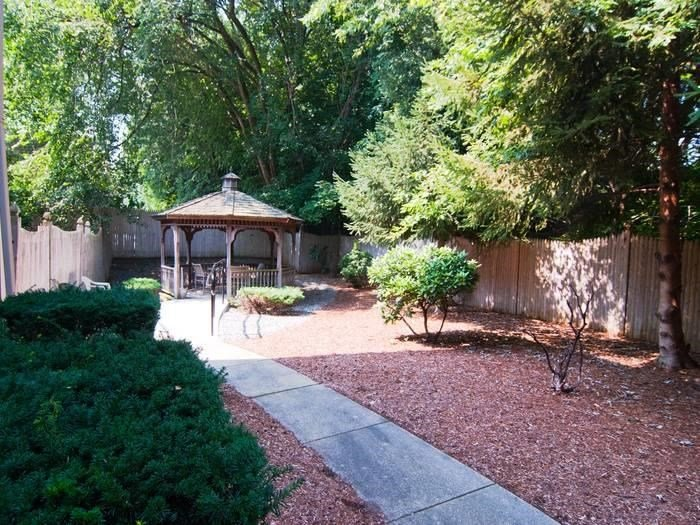 Beautiful Courtyard featuring a Specially Designed Walking Path and Pergolas at Pacifica Senior Living Victoria Court
