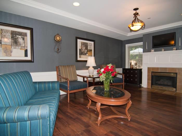 Gorgeous living room with a fireplace at Pacifica Senior Living Victoria Court
