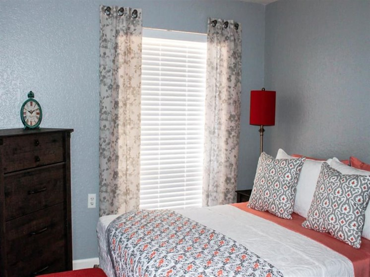 Well decorated master bedroom at Scottsdale Village Square, A Pacifica Senior Living Community in Scottsdale, Arizona