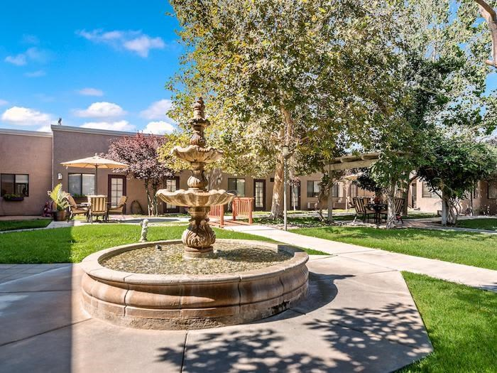 Peaceful fountain and walking pathways at Sierra Vista Independent and Assisted Living in Victorville, CA