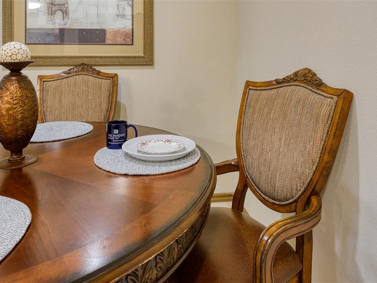 Apartment dining room, four seat wooden table and plates