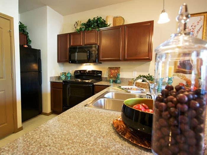 Kitchen in a senior living apartment at Meridian at Kessler Park