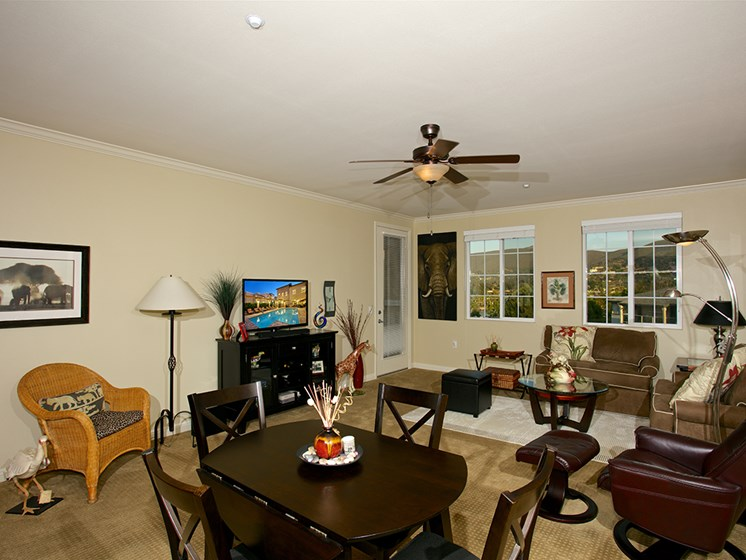 comfortable living and dining room at Meridian at Lake San Marcos in San Marcos, CA