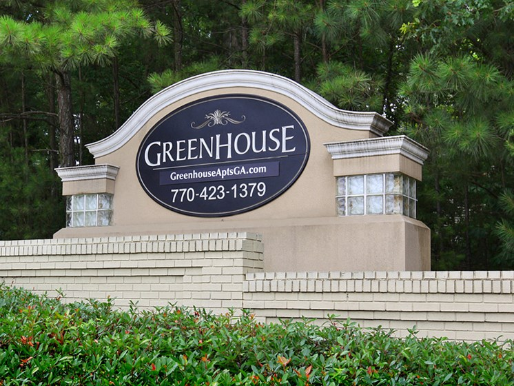 Greenhouse Apartments Sign