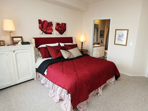 Bedroom at the Orchard Apartments in red