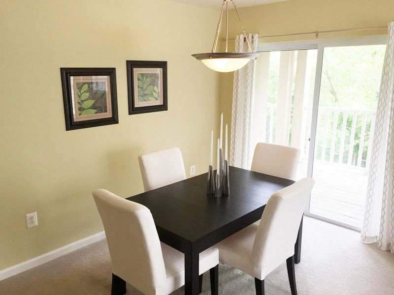 Dinning nook with sliding glass doors leading to the balcony at Village of Churchills Choice in Upper Marlboro, MD