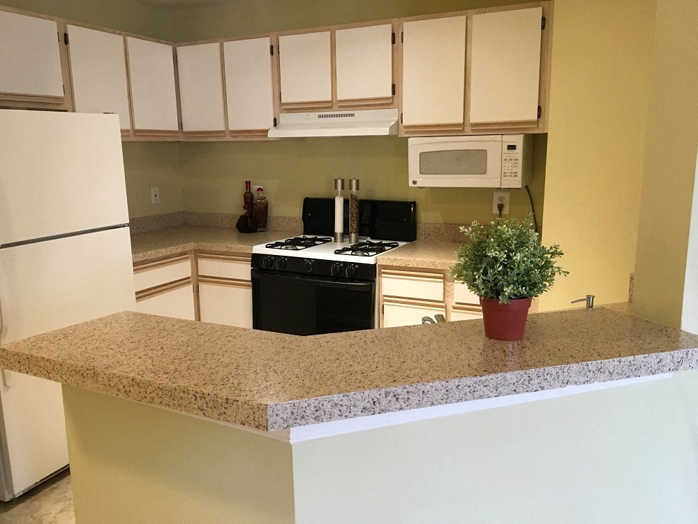 Open kitchen with a breakfast bar and built in microwave