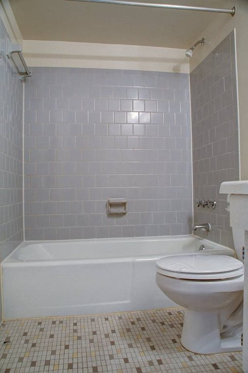 Tiled floor bathroom with subway tiled shower