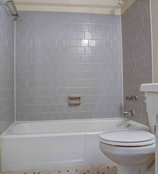 Tiled floor bathroom with subway tiled shower