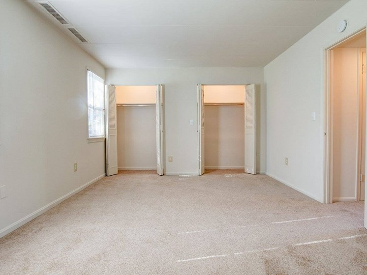 Large bedroom with two large closets with plenty of storage