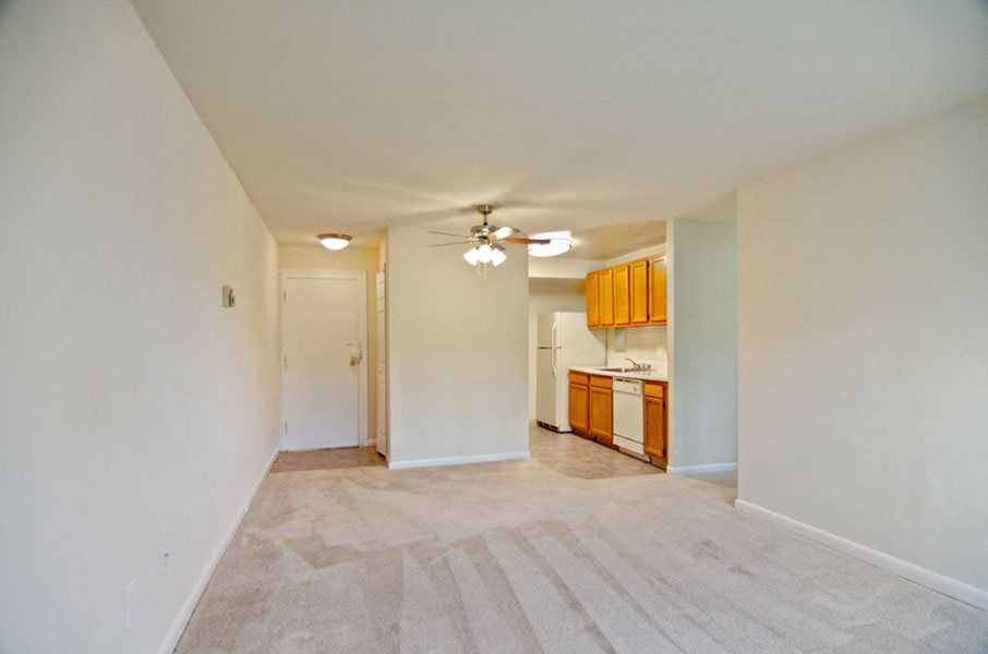 View of living area, kitchen, and entrance at Broadfalls in Falls Church, VA