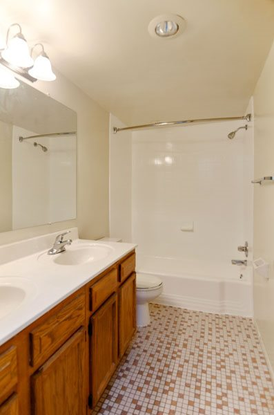 Bathroom with two sinks and tub at Broadfalls in Falls Church, VA