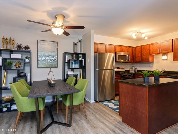 Open dinning nook with ceiling fan at Brook Run in Arlington Heights, IL