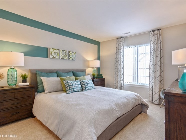 Large master bedroom with large windows at Brook Run in Arlington Heights, IL