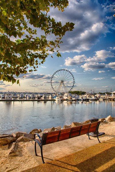 View of harbor and Ferris Wheel by Bridgeyard in Alexandria, VA