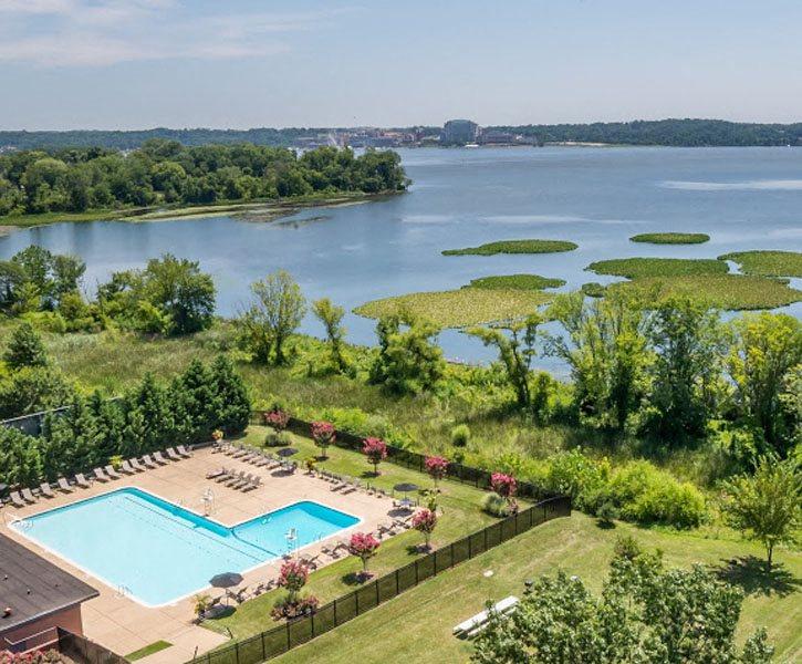 Aerial view of outdoor pool and river at Bridgeyard in Alexandria, VA