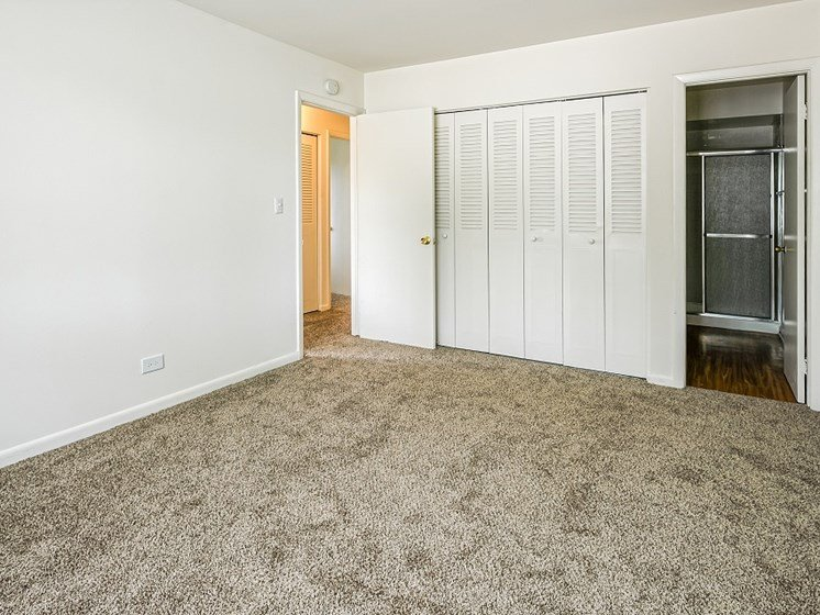 Large bedroom with large closets at Highcrest Townhomes in Woodridge, IL