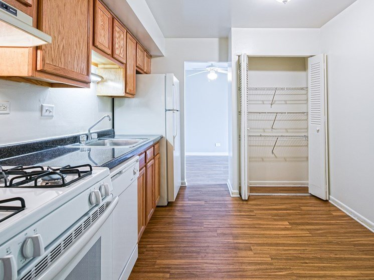 Open kitchen with plenty of storage space at Highcrest Townhomes in Woodridge, IL