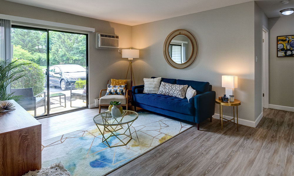 Bright Open Living Room with Wood Flooring - The Clayson