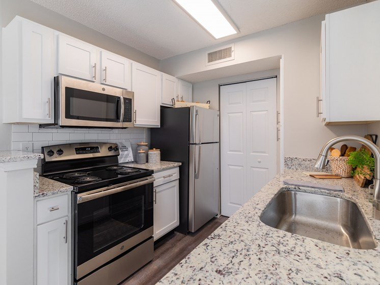Renovated interiors featuring granite countertops at The Arbors of Harbor Town Apartment Homes in Memphis, TN  38103