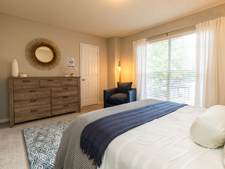 Renovated interiors featuring large picture windows and plush carpeting at Arbors Harbor Town in Memphis, TN  38103