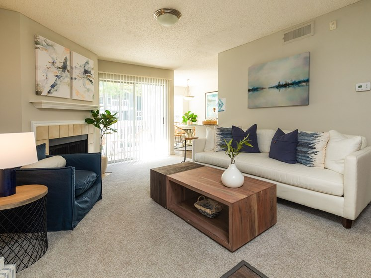 Renovated interiors featuring a gas burning fireplace at Arbors Harbor Town Apartment Homes in Memphis, TN 38103