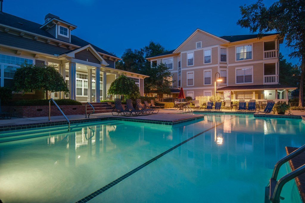 Revitalizing Resort Style Swimming Pool with Relaxation Space and Seating Area at Arbors Harbor Town Apartment Homes, Memphis, TN 38103