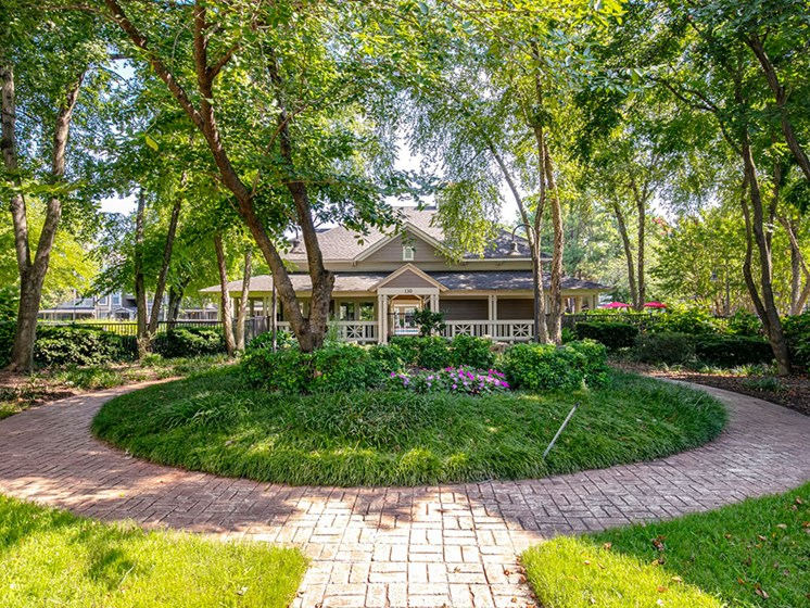 Lush landscaping surrounds you as you drive into the Leasing Office at Arbors Harbor Town Apartment Homes, Memphis, TN 38103