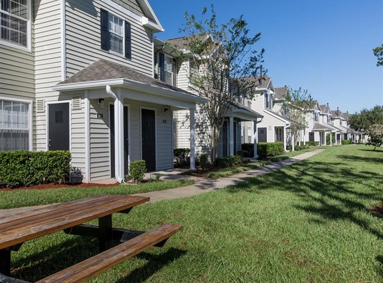 View of apartment entryways and park at Sunrise Point in Port Orange, FL