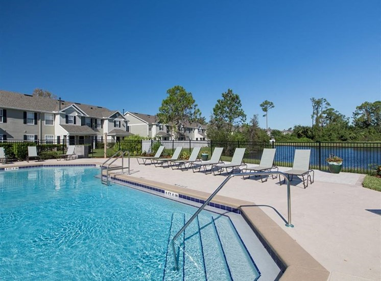 Large outdoor pool with lounge chairs at Sunrise Point in Port Orange, FL