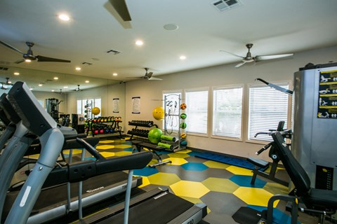 Fitness center with cardio equipment and weights from a different angle