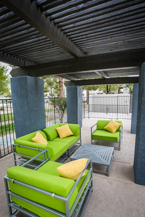 Outdoor seating area near pool