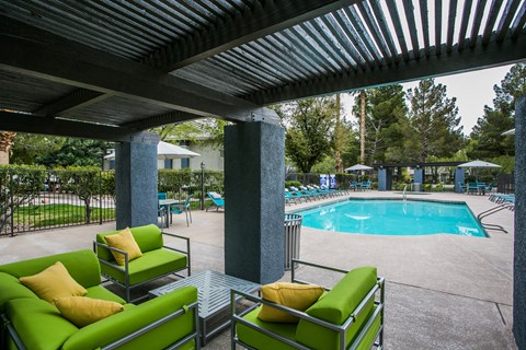 Outdoor seating area near pool from a different angle