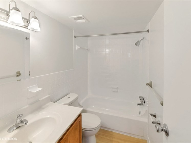 Large Soaking Tub In Master Bathroom with A Tile Surround at The Forest, Rockville