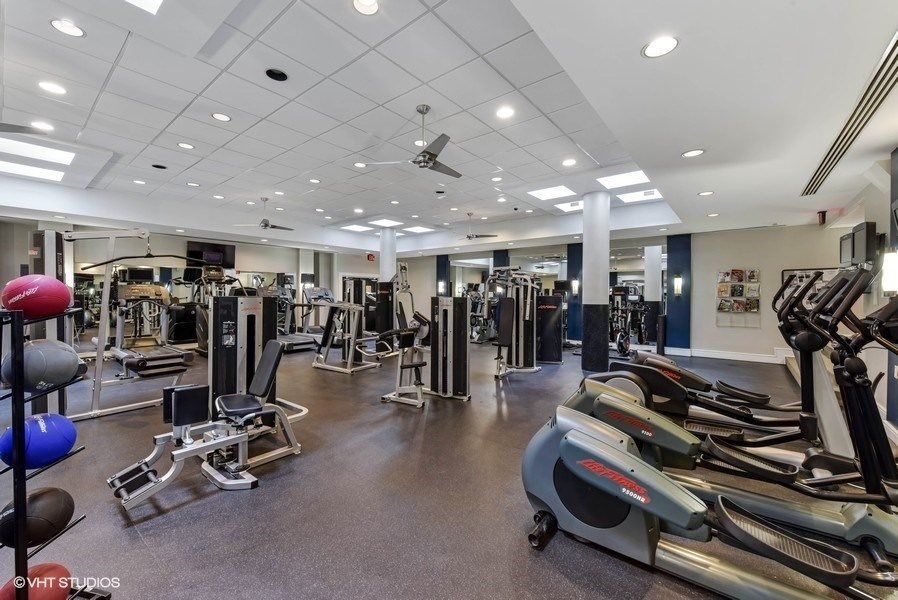 Large Fully-Equipped Fitness Center with Free Weights and Spin Bikes