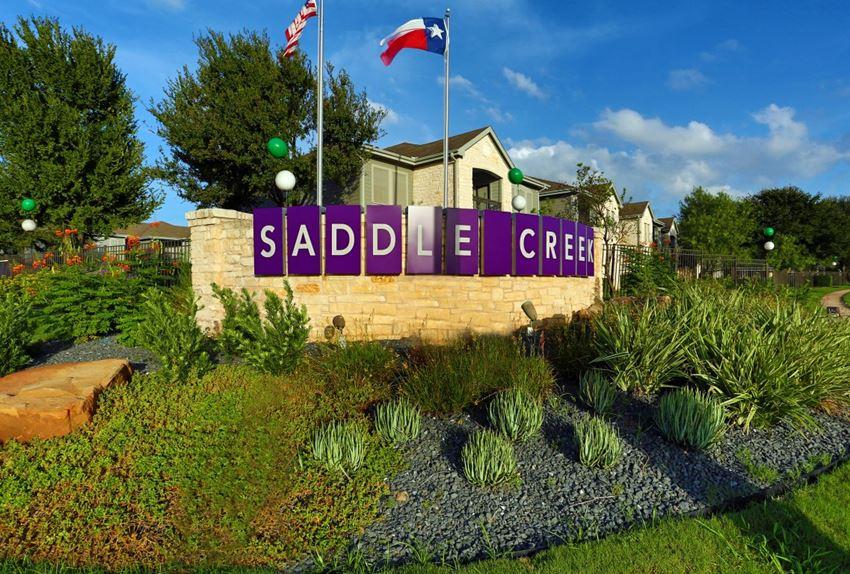 Welcoming Property Sign at Saddle Creek Apartments, Texas, 78748