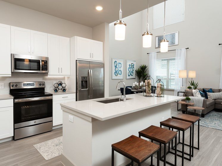 Modern kitchen with stainless steel appliances and double door refrigerators